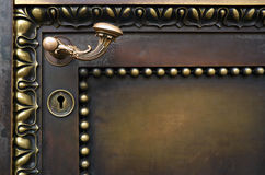Old door and curved handle. Royalty Free Stock Image