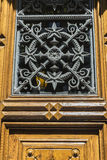 Old door decorated with wrought iron Royalty Free Stock Photo