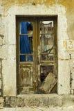 Old door in the destroyed building Stock Photo
