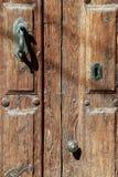 Old door. Detail of an old wooden door Royalty Free Stock Image