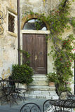 Old door entrance in a building from Tuscany Royalty Free Stock Photos