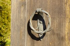 Old door with a forged handle royalty free stock image
