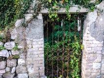 Garden gate. Metal gate set in stone at entrance to garden Royalty Free Stock Photos