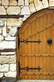 Old Door or Gate in White Stone Wall Stock Photography