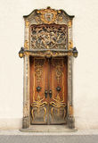 Old door with gold ornaments. An old wooden door with gold ornaments in old city Gdansk, Poland Royalty Free Stock Photography