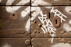Old door with graffiti Royalty Free Stock Photo