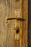 Old door handle. Wooden texture of old door with handle and keyhole, background Stock Photo