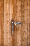 Old door handle on barn wooden door Royalty Free Stock Images
