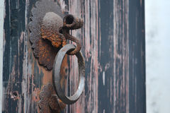 Old door handle. Handle closeup of wooden old door Royalty Free Stock Photography
