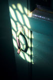 The old door handle in the dark room Stock Photography