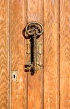 The old door handle in the form of key. Stock Images