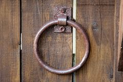 Old door handle in the form of a ring stock image