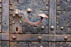 Old door handle on iron medieval door in Gdansk, Poland. Royalty Free Stock Images