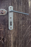 Old door handle with keyhole Stock Images