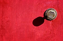 Old door handle on red door Royalty Free Stock Image