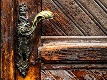 Old door handle - rustic door. Old brown background. Artistic masterpiece stock image
