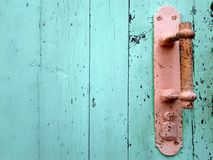 Old door handle. Old rusty door handle closeup Stock Image