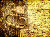 Old door handle vintage effect. Textured gritty detail with soft focus and vintage look intentionally for effect Stock Photos