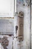Old door handle wooden. Old wooden door with a door handle with a shabby paint Stock Photos