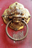Old door handles in the chinese temple. Royalty Free Stock Photos