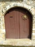 Old door in herault, languedoc, france. Old door in herault, a department of the region Languedoc, france royalty free stock photos