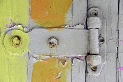 Old door hinge with tropical colors stock images