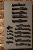 Old door holes and handles - Wooden entrance on brick walls - Handles made of metal stock image
