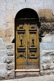 Old door into a home in Europe Royalty Free Stock Photography