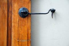Old door with hook. Old door with metal hook Royalty Free Stock Images