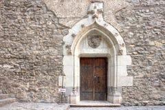 Corvin`s Hunyadi Castle in Hunedoara, Romania. Old door inside Corvin`s Hunyadi Castle. A historic monument and major tourist attraction in Hunedoara, Romania Royalty Free Stock Photos