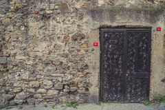 Old door inside wall Royalty Free Stock Photos