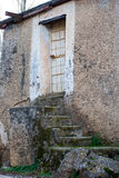 Old door with iron bars Stock Photography