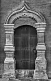 Old door. Iron old black and white door Royalty Free Stock Images