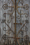 Old door with iron decoration Stock Photos