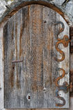 Old door with iron hinges Stock Image