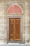 Old door, istanbul, turkey. Old door in the courtyard of prince (sehzade) mosque, built in 1548, for son of ottoman sultan suleyman the magnificent Royalty Free Stock Photo