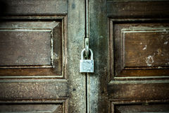 The old door with a key lock Stock Images