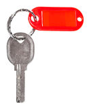 Old door key with red blank keychain isolated Royalty Free Stock Images