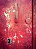 Old door keyhole and handle. Re handle and keyhole on old red wooden door stock photography
