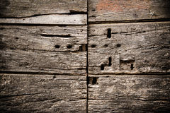 Old door with keyholes Stock Image