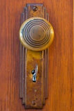 Old Door knob with key Stock Photo