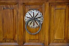 Old door knocker. Old metal door handle knocker on wooden background Stock Photography