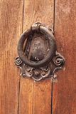Old door knocker and as a bell to call people Royalty Free Stock Image