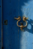The old door knocker on the blue. Stock Images