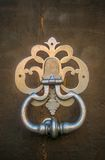 Old door knocker in Gourdon Stock Image