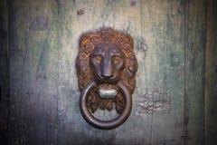Old door knocker Stock Images