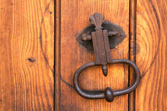 Old Door Knocker. Wood wall Stock Images