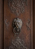 The old door knocker on a wooden door Royalty Free Stock Photo