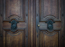 The old door knocker on a wooden door Royalty Free Stock Images