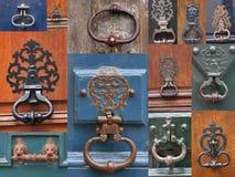 The old door knockers on the doors of homes in Paris Stock Photos